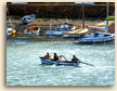 Three Boys in a Boat at Mousehole in Cornwall